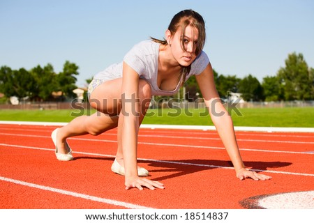 Healthy, female athlete ready to race. - stock photo