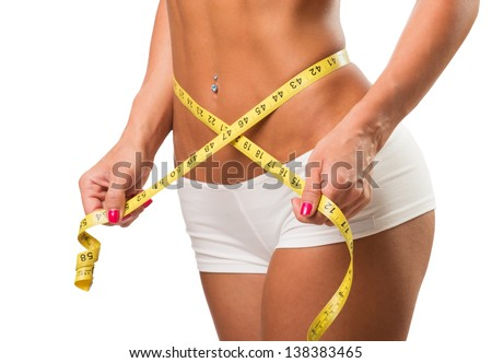 Healthy female body with measuring tape - stock photo