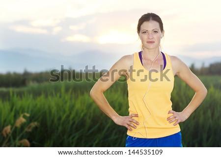 Healthy female Runner at Sunrise - stock photo