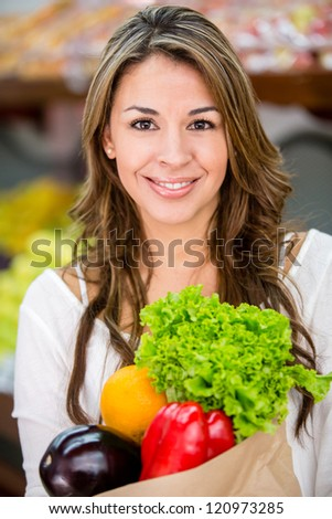 Healthy female shopping buying fresh groceries - stock photo