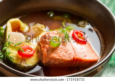 Healthy fish soup made of salmon and trout - stock photo