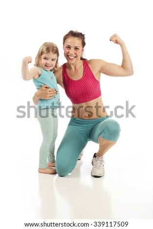 Healthy fit mom and child flexing on white studio background - stock photo