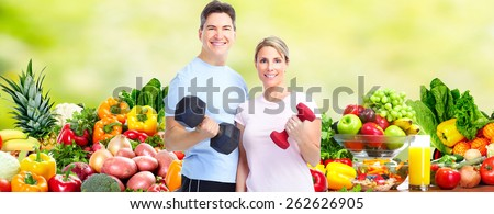 Healthy fitness couple. Health care and diet background. - stock photo