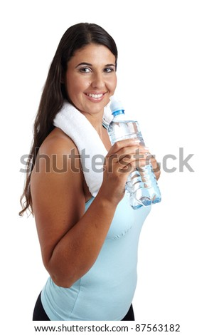 Healthy fitness girl drinking water