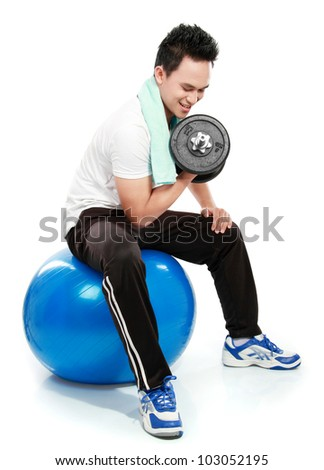 healthy fitness man exercising with dumbbells sit on pilates ball isolated on white background - stock photo