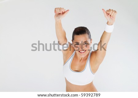 healthy fitness woman giving thumbs up - stock photo