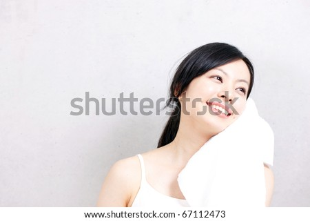 Healthy fitness woman with towel