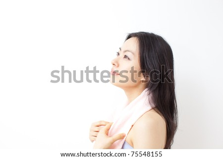 Healthy fitness woman with towel - stock photo