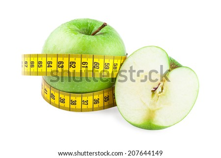 Healthy food and diet concept. Green apples and measuring tape isolated on  white background