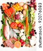 Healthy Food Assortment with Fish, Eggs, Vegetables, Fruit and Cured Meats for Healthy Diet full of Antioxidants and Vitamins - stock photo