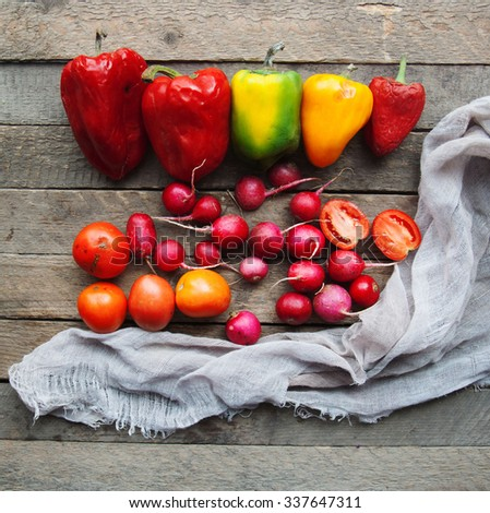 Healthy food background ,studio photography of different fruits and vegetables on old wooden table, abstract design background vegetables on a wooden background, tomato,pepper, harvest - stock photo