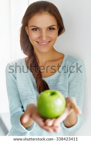 Healthy Food. Beautiful Happy Young Woman With Fresh Green Apple. Healthy Eating. Fruits. Diet. Dieting Concept. Healthy Lifestyle Concept. - stock photo