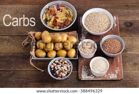 Healthy Food: Best Sources of Carbs on a rustic wooden background. Top view - stock photo