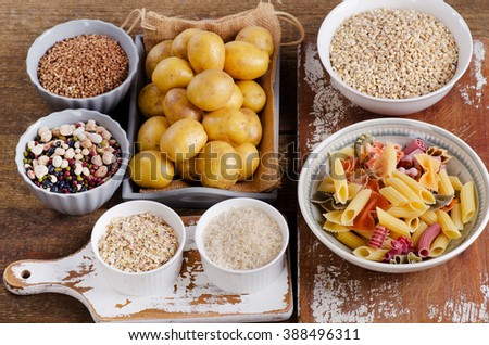 Healthy Food: Best Sources of Carbs on a wooden board. Top view - stock photo