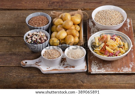Healthy Food: Best Sources of Carbs on wooden board. Top view - stock photo