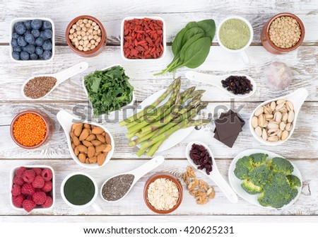 Healthy food called super foods on white, wooden background, top view - stock photo
