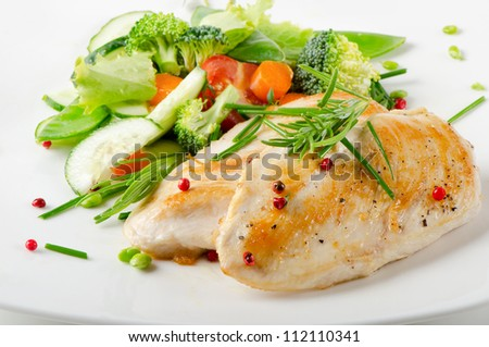 Healthy food - chicken fillet with vegetables - stock photo