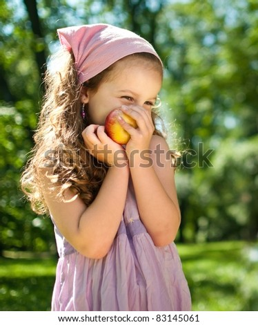 Healthy food - child with apple - stock photo