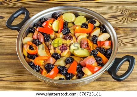 Healthy food, colorful stewed various vegetables in pan on wooden background
