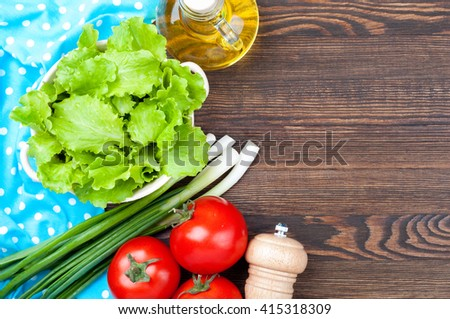 Healthy food concept background with copy space. Organic rural vegetables - lettuce, green onions, tomatoes and olive oil, salt on wooden table. Cooking salad. Top view - stock photo