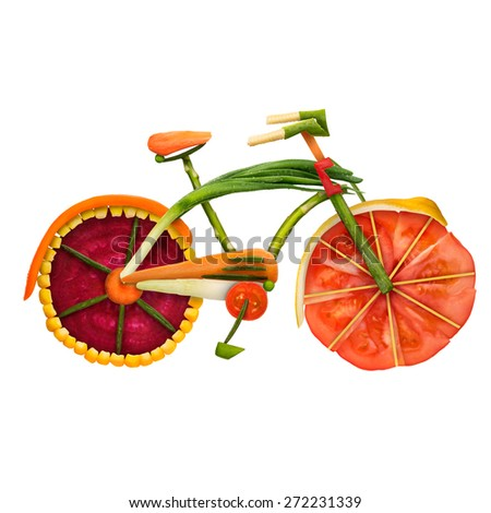 Healthy food concept of an urban fixed gear bicycle in detail made of fresh vegetables full of vitamins, isolated on white background. - stock photo