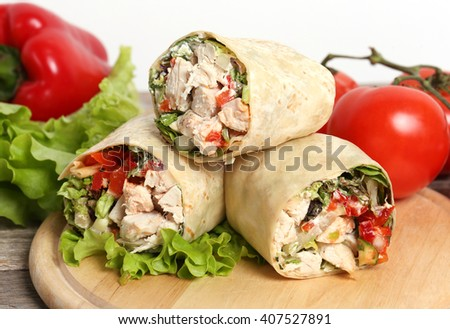 Healthy food. Delicious chicken wrap with vegetables - stock photo