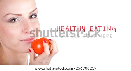 Healthy food - Eating fruit and vegetable - Beautiful young woman eating a tomate - Weight loss diet - Isolated on white with place for your text - stock photo