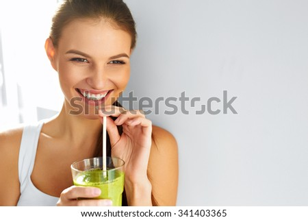 Healthy Food Eating. Happy Beautiful Smiling Woman Drinking Green Detox Vegetable Smoothie. Diet. Healthy Lifestyle, Vegetarian Meal. Drink Juice. Health Care And Beauty Concept. - stock photo
