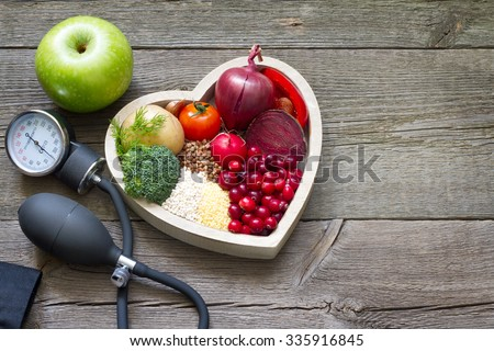 Healthy food in heart and cholesterol diet concept on vintage boards - stock photo