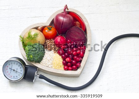 Healthy food in heart and lowering pressure sign concept - stock photo