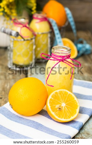 Healthy food, lemon smoothie with lemon fruits on the wooden background