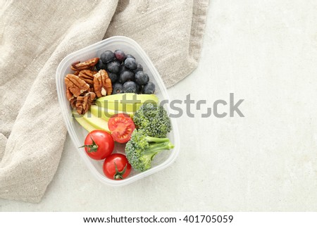 Healthy food. Lunch box on the table - stock photo