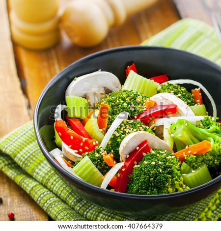 Healthy food made of broccoli, onion, mushroom, carrot and pepper. Vegetarian salad. - stock photo