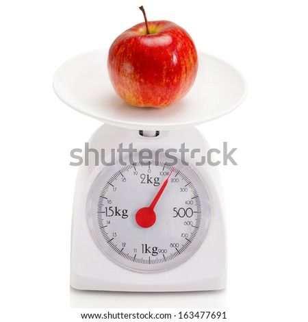 Healthy food on balance scale.