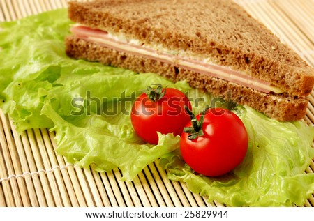 Healthy food: sandwich made with whole grain bread, cheese and bacon,  lettuce and tomatoes