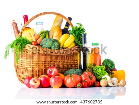 Healthy food shopping. A basket full with shopping products and ingredients. organic vegetables and fruits. Isolated on white background