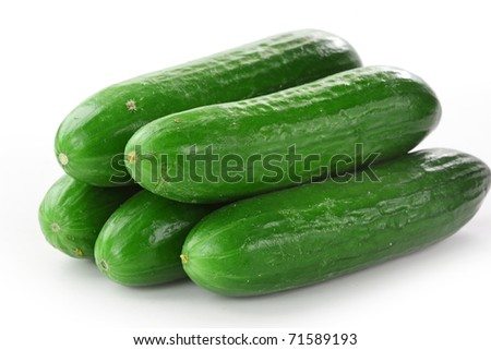 Healthy food. The green cucumbers isolated on white background