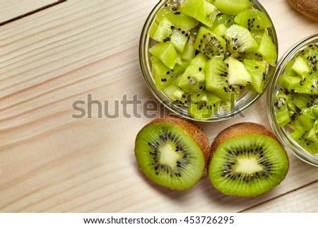 Healthy food. Tropical fruit. Whole and sliced kiwi. Kiwi fruit. Still life. Juicy kiwi on the wooden table - stock photo