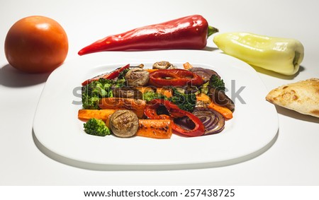 Healthy food, various vegetables grilled and served on white plate.