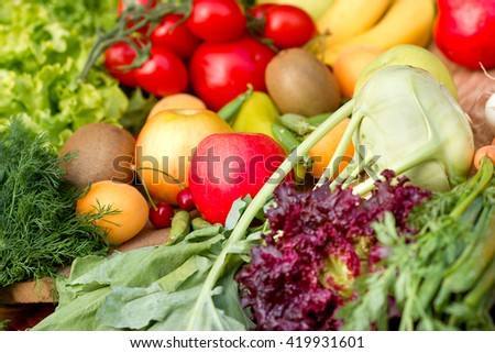 Healthy food - vegetarian food (organic fruits and vegetables) - stock photo