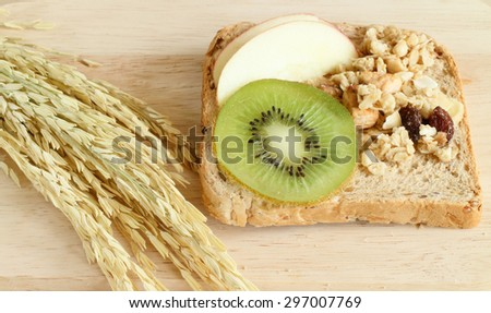 healthy food, whole wheat bread and kiwifruit with apple sliced on wood table - stock photo