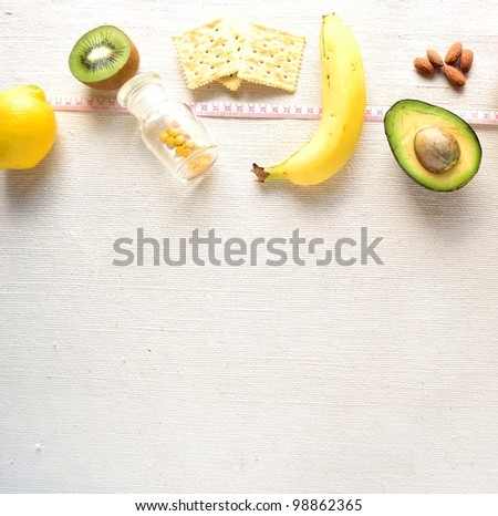 Healthy food with tape measure - stock photo