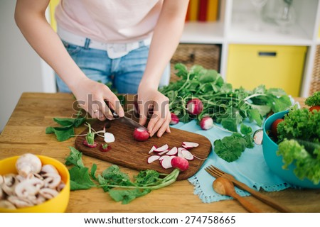 Healthy food. Woman preparing mushrooms and vegetables