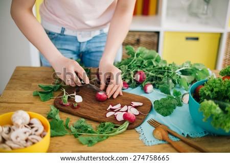 Healthy food. Woman preparing mushrooms and vegetables - stock photo