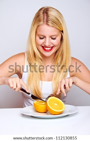 healthy food - young blond girl - stock photo