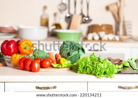 healthy foods are on the table in home kitchen - stock photo