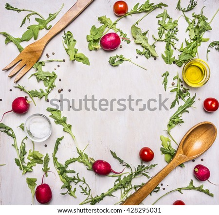 Healthy foods, cooking and vegetarian concept salad with cherry tomatoes, radishes, spices and wooden spoon and for place for text,frame