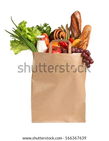 Healthy foods to buy / studio photography of brown grocery bag with fruits, vegetables, bread, bottled beverages - isolated over white background  - stock photo