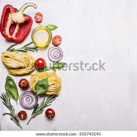 Healthy foods,  vegetarian concept cooking pasta with flour, vegetables, oil and herbs, onion, pepper on wooden rustic background top view border, place for text  - stock photo