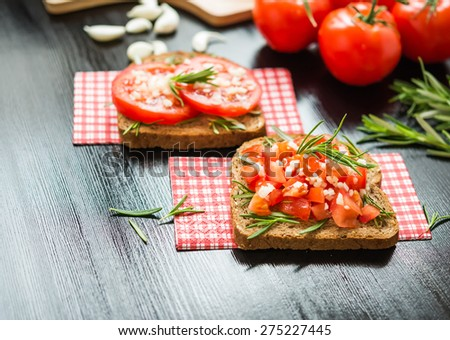 Healthy Foods. Vegetarian food. Sandwiches with vegetables. Italian Bruschetta. Bread with chopped tomatoes, garlic, rosemary.  - stock photo